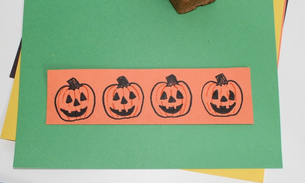 Cut out the Orange Jack -o-lanterns and glue to green paper