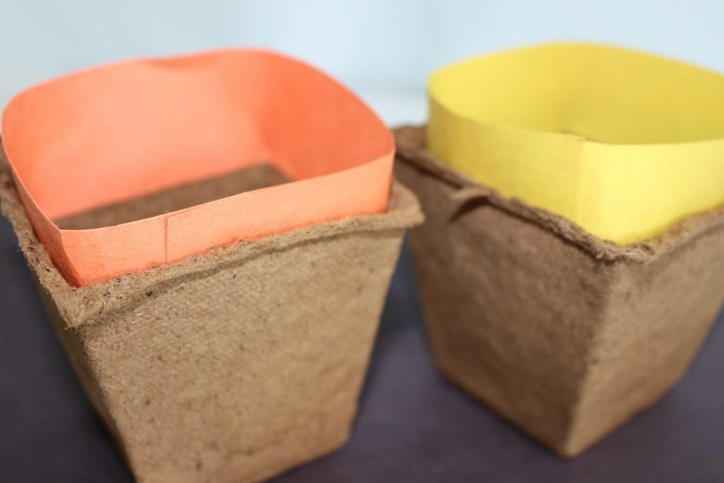 Cut strips of paper and glue to the inside tops of the baskets